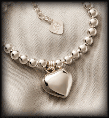 Heart necklace heart pendant heart bracelet sterling silver heart a sterling silver puffed heart pendant hand crafted in mexico gives a soft heart warming jingle when shaken suspended on a 20 inch sterling silver snake aloadofball Images